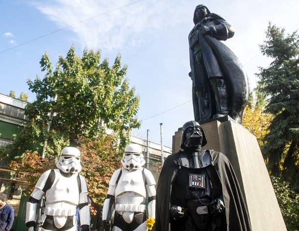 "TO GO WITH AFP STORY BY OLGA SHYLENKO People dressed as characters from 'Star Wars' film take part in an inauguration ceremony of a Darth Vader monument, formerly a statue of Soviet founder Lenin, in the southern Ukrainian city of Odessa on October 23, 2015. Just in time for the release of the latest ""Star Wars"" blockbuster, Ukrainians have transformed the statue of Lenin into one of Darth Vader, an oddly prominent figure in local politics. AFP PHOTO / VOLODYMYR SHUVAYEV"